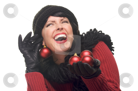 Attractive Woman Holding Red Ornaments stock photo, Attractive Woman Holding Red Ornaments Isolated on a White Background. by Andy Dean
