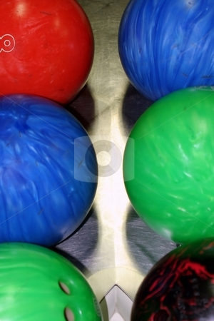Bowling Balls stock photo, Blue red green and multi color bowling balls by Henrik Lehnerer
