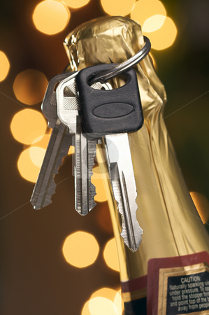 Don't Drink and Drive - Keys and Champagne stock photo, Don't Drink and Drive - Keys and Champagne in Holiday Abstract Background. by Andy Dean