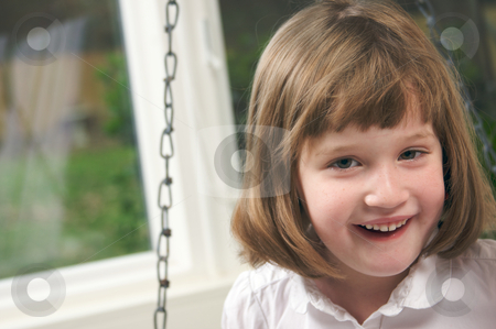Adorable Girl Poses stock photo, Adorable Girl Poses for a Fun Portrait by Andy Dean