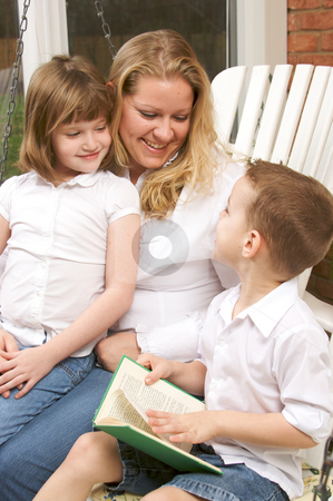 Young Boy Reads to His Mother and Sister stock photo, Young Boy Reads to His Mother and Sister by Andy Dean