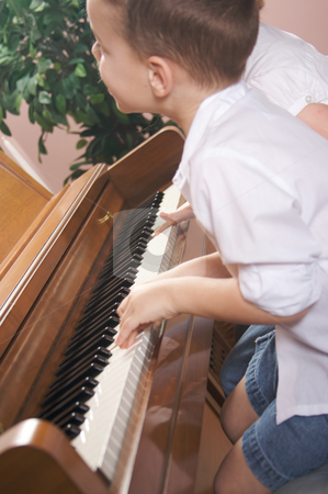 Children Playing the Piano stock photo, Brother and Sister Playing the Piano Together by Andy Dean