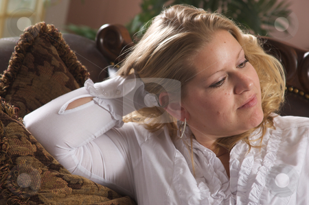 Pensive Attractive Woman stock photo, Pensive Attractive Woman Relaxing on Her Couch by Andy Dean