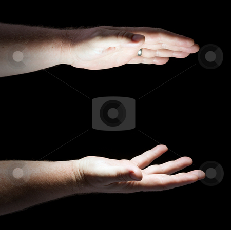 Glowing Hands stock photo, Glowing Hands on Black Background Ready for Your Product. by Andy Dean