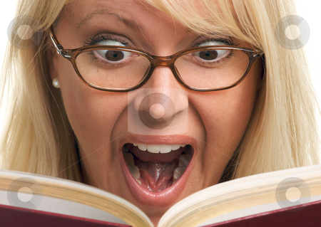 Attractive Woman Taken Back While Reading  stock photo, Attractive Woman Taken Back While Reading isolated on a White Background. by Andy Dean