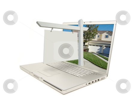 Blank Real Estate Sign & Laptop stock photo, Blank Real Estate Sign & New Home on Laptop isolated on a white Background. by Andy Dean