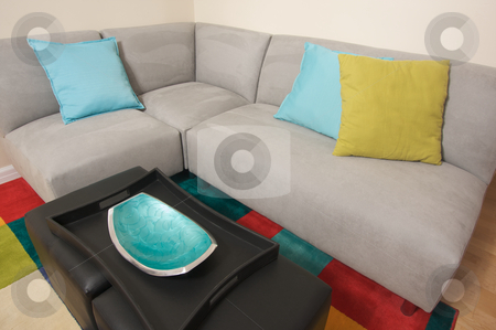 Grey Suede Couch Corner Area stock photo, Grey Suede Couch Corner Area with colorful rug and pillows. by Andy Dean