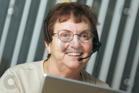 Smiling Senior Adult with Telephone Headset stock photo, Smiling Senior Adult with Telephone Headset by Andy Dean