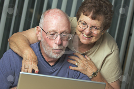 Senior Adults on Laptop Computer stock photo, Senior Adults on Working on a Laptop Computer by Andy Dean