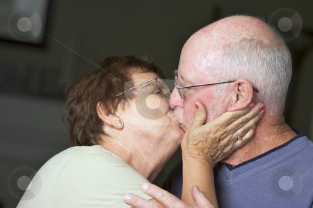 Happy Senior Adult Couple stock photo, Happy Senior Adult Couple Kissing by Andy Dean