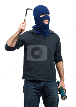 Isolated Burglar stock photo, A burglar isolated against a white background and holding a crowbar and flashlight by Richard Nelson