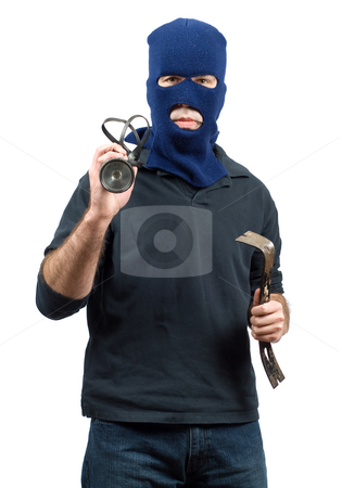 Isolated Burglar stock photo, Isolated burglar holding a crowbar and a flashlight by Richard Nelson