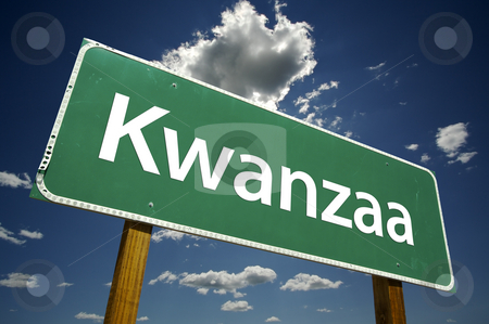 Kwanzaa Road Sign with Dramatic Clouds stock photo, Kwanzaa Road Sign with dramatic clouds and sky. by Andy Dean