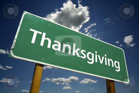 Thanksgiving Road Sign with Dramatic Clouds stock photo, Thanksgiving Road Sign with dramatic clouds and sky. by Andy Dean