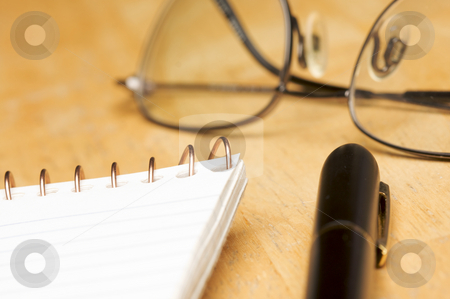 Pen, Pad and Glasses Abstract stock photo, Pen, Pad and Glasses on a Wood Background with Narrow Depth of Field. by Andy Dean