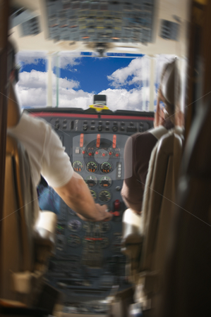 Jet Cockpit with Pilots and Clouds stock photo, Jet Cockpit with Pilots and Clouds - motion added. by Andy Dean