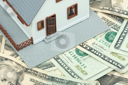 Home and Money stock photo, Home and Money on a Money Background by Andy Dean