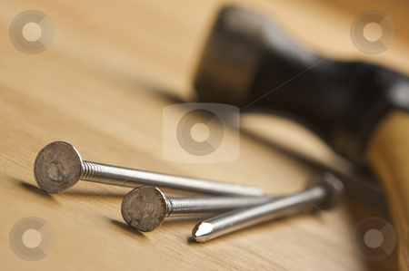 Hammer and Nails Abstract stock photo, Hammer and Nails Abstract on Wood Background. by Andy Dean