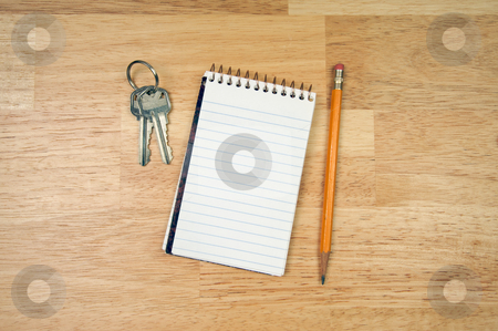 Pad of Paper, Pencil and Keys stock photo, Pad of Paper, Pencil and Keys on a Wood Background. by Andy Dean