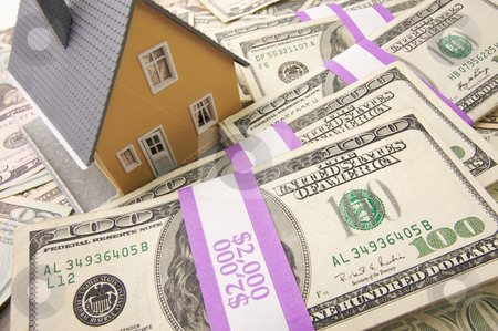 Home and Money stock photo, Home with Stacks of Money as Background. by Andy Dean