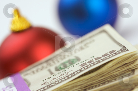 Money and Ornaments stock photo, Money and Christmas Ornaments with Narrow Depth of Field. by Andy Dean