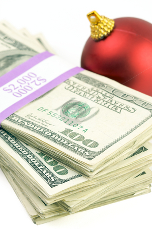 Money and Ornament stock photo, Money and Christmas Ornament on a White Background. by Andy Dean