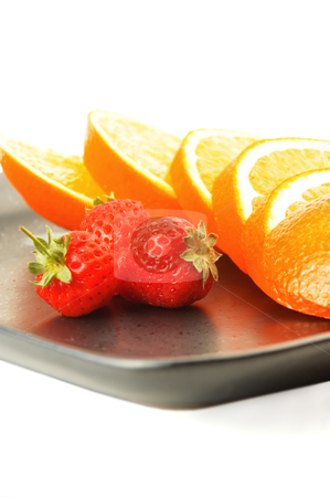 Orange & strawberries stock photo, Orange & strawberries on a plate on white background by Francesco Perre