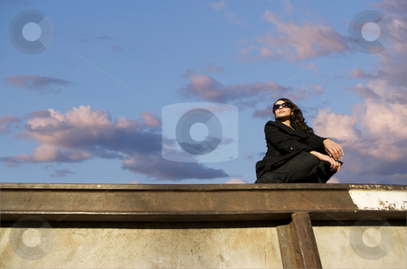 Pretty Hispanic Woman stock photo, Pretty Hispanic woman with dark sunglasses in an urban setting by Scott Griessel