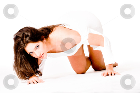 Brunette in white shirt on white background high key on her knee stock photo, High key portrait of a brunette girl flirting with the viewer by Frenk and Danielle Kaufmann