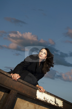 Pretty Hispanic Woman stock photo, Pretty Hispanic woman in urban setting against a big sky by Scott Griessel