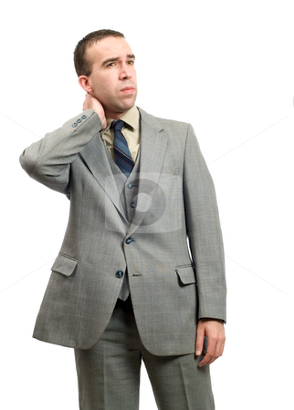 Businessman With Stiff Neck stock photo, A businessman suffering from a stiff neck, isolated against a white background by Richard Nelson