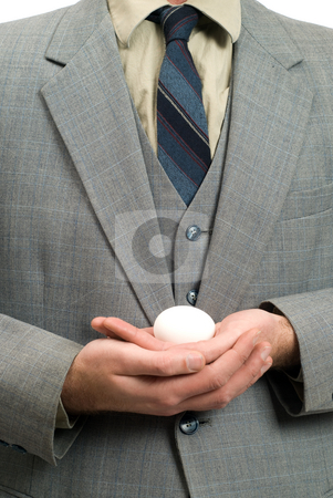 Fragile Jobs stock photo, Concept image of a businessman holding a small egg, protecting his new business by Richard Nelson