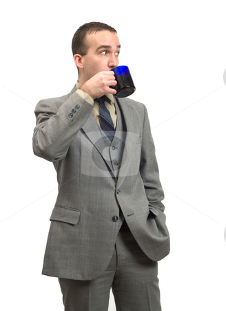 Businessman Drinking Coffee stock photo, A young businessman drinking a cup of coffee, isolated against a white background by Richard Nelson