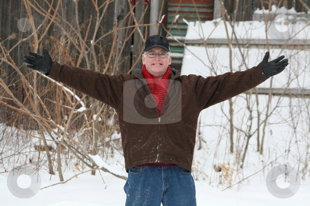 Welcoming Man, Winter stock photo, A happy man, with his arms outstretched in a warm welcome, on a cold winter day by Tom and Beth Pulsipher