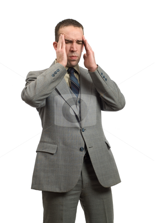 Mental Stress stock photo, A businessman getting a headache from all the mental stress he is having by Richard Nelson
