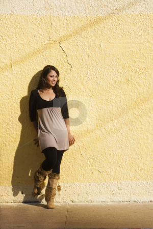 Woman with shadows stock photo, Pretty Hispanic woman against a cracked wall with afternoon shadows by Scott Griessel