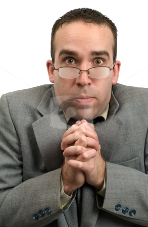 Cold Businessman stock photo, A businessman looks freezing cold with fogged up glasses, isolated against a white background by Richard Nelson