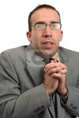 Business Man Shivering stock photo, A young businessman came in from the cold and is shivering, with his glasses fogged up by Richard Nelson