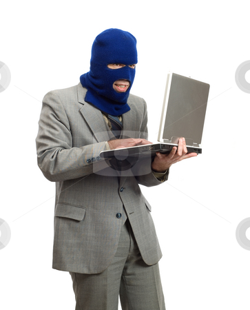 Hacker stock photo, A hacker wearing a business suit is stealing company secrets by Richard Nelson
