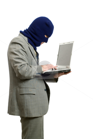 Computer Thief stock photo, A computer thief wearing a business suit is stealing private information by Richard Nelson