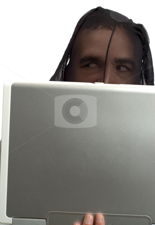 Hacker stock photo, A male hacker wearing a pair of stockings, is working on a laptop computer, isolated against a white background by Richard Nelson