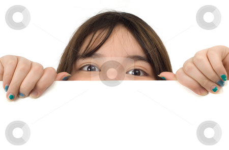 Peeking stock photo, Young girl trying to look over a white wall by Richard Nelson