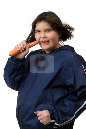 Healthy Lifestyle stock photo, A young girl eating a carrot while jogging to help get into a healthy lifestyle by Richard Nelson