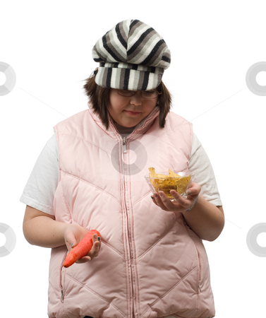 Healthy vs Unhealthy stock photo, A young girl deciding if she wants to eat a healthy or unhealthy snack, isolated against a white background by Richard Nelson