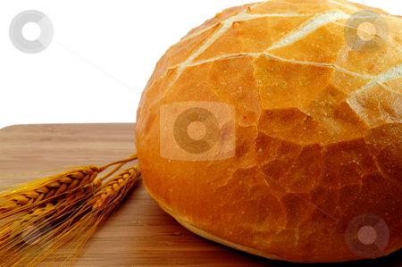Bread And Wheat stock photo, Sourdough bread  and wheat stalks on a cutting board by Lynn Bendickson