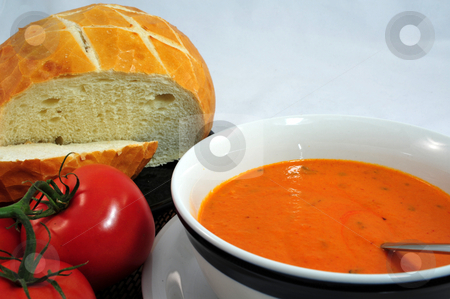 Sourdough Bread And Tomato Soup stock photo, Hot Tomato soup in a bowl with bread on the side by Lynn Bendickson
