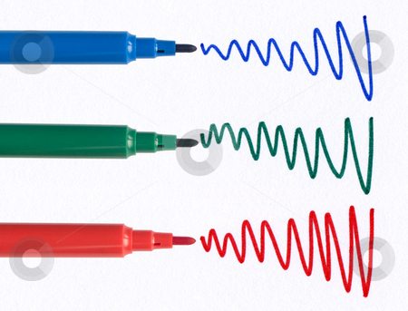 Red green and blue felt tip pen squiggles on white paper. stock photo, Red green and blue felt tip pen squiggles on white paper. by Stephen Rees