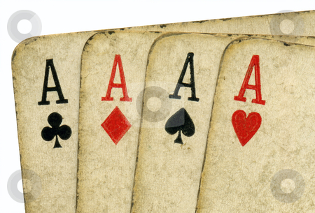 Close up of 4 old vintage dirty aces poker cards. stock photo, Close up of 4 old vintage dirty aces poker cards. by Stephen Rees
