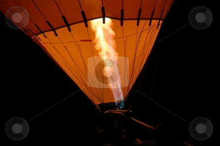 Hot Air Balloon stock photo, Hot air balloon with flames from the burner at night to show a glow. by Henrik Lehnerer
