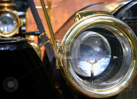 Old Headlights stock photo, Two brass headlight of an old car by Henrik Lehnerer